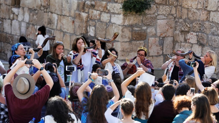 Members of Women of the Wall blow shofars during a prayer service marking the first day of the Jewish month of Elul, on August 23, 2017, at the Western Wall in Jerusalem's Old City. (AFP Photo/Menahem Kahana)