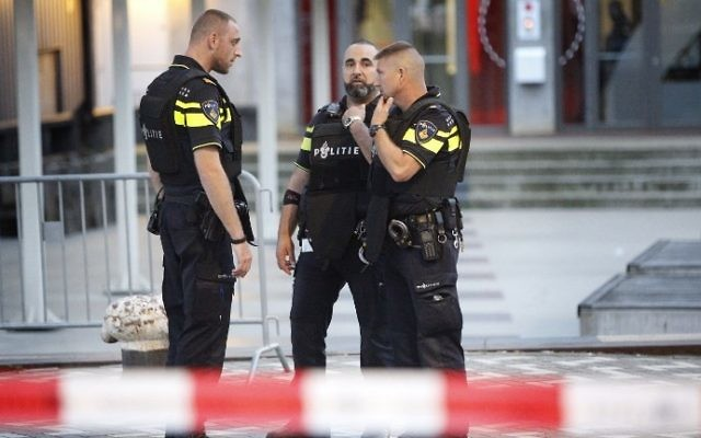 Illustrative: Police are seen in the Dutch city of Rotterdam after a concert by Californian ban Allah-Las was canceled over a terror threat on August 23, 2017. (AFP Photo/ANP/Arie Kievit)