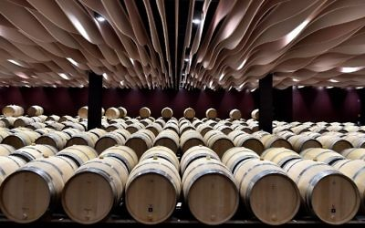 This file photo taken on March 30, 2017, shows wine barrels in the wine cellar of the Chateau de Beychevelle in Saint Julien de Beychevelle. (AFP Photo/Georges Gobet)