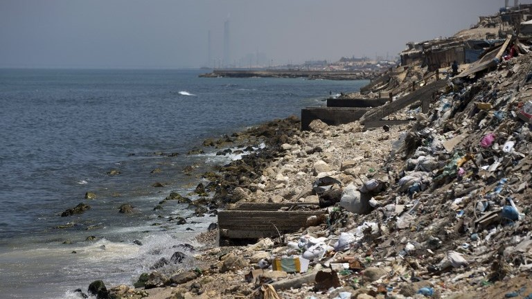 This file photo taken on July 2, 2017, shows trash strewn along the coastline in Gaza City. (AFP Photo/Mahmud Hams)
