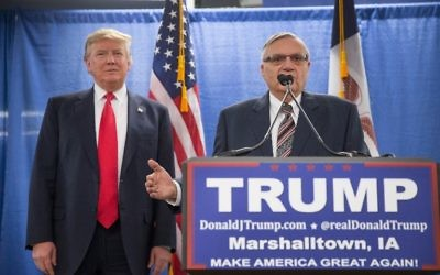 This file photo taken on January 26, 2016 shows Sheriff Joe Arpaio (R) endorsing Republican presidential candidate Donald Trump prior to a rally in Marshalltown, Iowa.  (AFP PHOTO / GETTY IMAGES NORTH AMERICA / SCOTT OLSON)