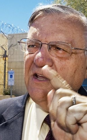 This file photo taken on May 3, 2010 shows Maricopa County Sheriff Joe Arpaio outside his famous tent city jail for misdemeanor offenses May 3, 2010, in Phoenix, Arizona. ( AFP PHOTO / Paul J. RICHARDS)