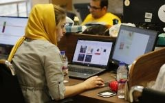 This file photo taken on July 9, 2017, shows Bamilo employees working at the e-commerce site's offices in the Iranian capital Tehran. (AFP Photo/Atta Kenare)