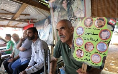 Relatives of Lebanese soldiers taken hostage by jihadists in 2014 sit inside a tent as they gather in downtown Beirut on August 27, 2017 awaiting news of their loved ones. (AFP PHOTO / ANWAR AMRO)