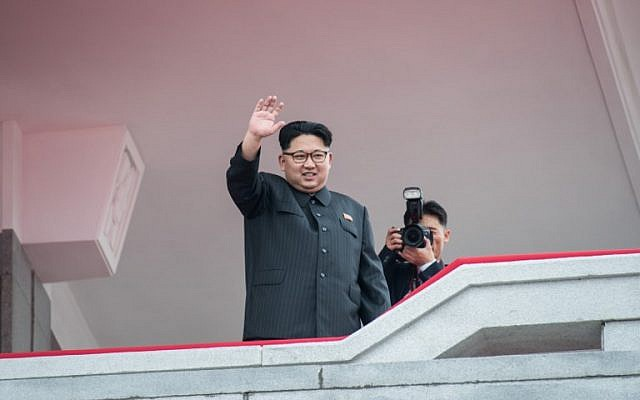 This file photo taken on May 10, 2016 shows North Korean leader Kim Jong-Un waving from a balcony of the Grand People's Study House to participants of a military parade and mass rally on Kim Il-Sung square in Pyongyang. (AFP PHOTO / Ed Jones)