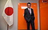 Japan's Deputy Prime Minister and Finance Minister Taro Aso posing before a meeting during a G7 summit of Finance Ministers in Bari, May 13, 2017. (AFP/Alberto PIZZOLI)