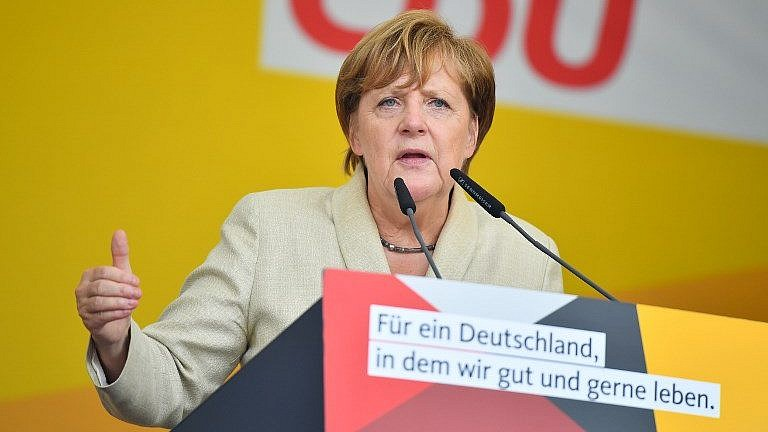 German Chancellor Angela Merkel addresses an election campaign rally for her Christian Democratic Union party in Ludwigshafen, Germany, on August 30, 2017. (AFP Photo/dpa/Uwe Anspach)