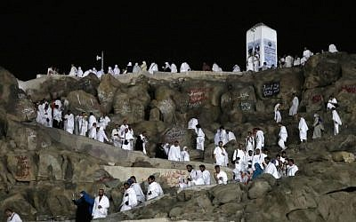 Muslim pilgrims walk and pray on Mount Arafat, also known as Jabal al-Rahma (Mount of Mercy), southeast of the Saudi holy city of Mecca, on the eve of Arafat Day which is the climax of the Hajj pilgrimage on August 30, 2017. (Karim Sahib/AFP)