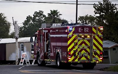 A firetruck waits at a roadblock after an explosion at a chemical plant operated by the Arkema Group during the aftermath of Hurricane Harvey, in Crosby, Texas,August 31, 2017. (AFP/Brendan Smialowski)