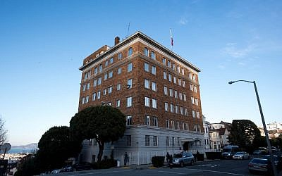 This photo taken on December 29, 2016 shows people walking past the Consulate-General of Russia in San Francisco, California. (AFP PHOTO / Josh Edelson)