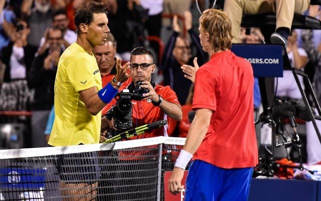 Rafael Nadal of Spain congratulates Denis Shapovalov of Canada for his victory during day seven of the Rogers Cup at Uniprix Stadium on August 10, 2017 in Montreal, Quebec, Canada. Denis Shapovalov of Canada defeated Rafael Nadal of Spain 6-3, 4-6, 6-7. (Minas Panagiotakis/Getty Images/AFP)