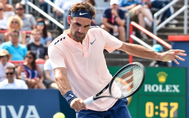 Roger Federer of Switzerland hits a return against Roberto Bautista Agut of Spain during day eight of the Rogers Cup presented by National Bank at Uniprix Stadium on August 11, 2017 in Montreal, Quebec, Canada. (Minas Panagiotakis/Getty Images/AFP)