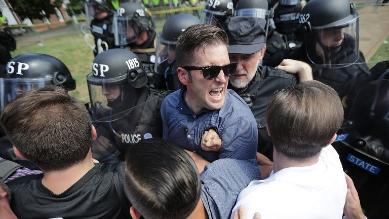 White nationalist Richard Spencer, center, and his supporters clash with Virginia State Police in Lee Park after the 'Unite the Right' rally was declared an unlawful gathering August 12, 2017 in Charlottesville, Virginia. (Chip Somodevilla/Getty Images/AFP)