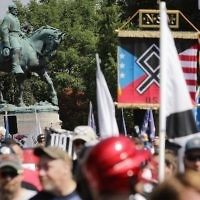 A statue of Confederate General Robert E. Lee stands behind a crowd of hundreds of white nationalists, neo-Nazis and members of the 'alt-right' during the 'Unite the Right' rally August 12, 2017 in Charlottesville, Virginia. (Chip Somodevilla/Getty Images/AFP)