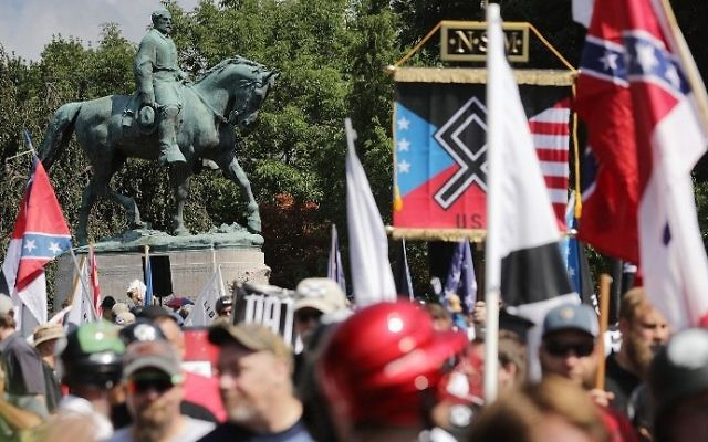 "The statue of Confederate General Robert E. Lee stands behind a crowd of hundreds of white nationalists, neo-Nazis and members of the ""alt-right"" during the ""Unite the Right"" rally August 12, 2017 in Charlottesville, Virginia. (Chip Somodevilla/Getty Images/AFP)"