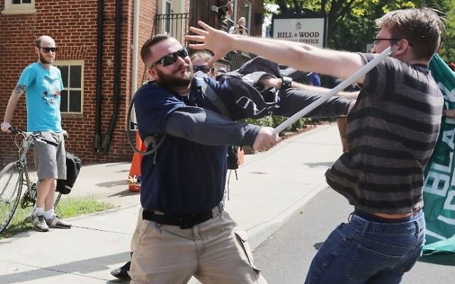 "White nationalists clash with counter-protesters in the street after the ""Unite the Right"" rally was delcared a unlawful gathering by Virginia State Police August 12, 2017 in Charlottesville, Virginia. (Chip Somodevilla/Getty Images/AFP)"