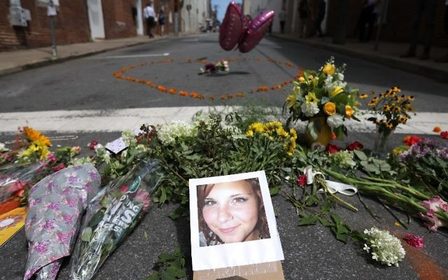 Flowers surround a photo of 32-year-old Heather Heyer, who was killed when a car plowed into a crowd of people protesting against the white supremacist Unite the Right rally, August 13, 2017 in Charlottesville, Virginia. (Chip Somodevilla/Getty Images/AFP)