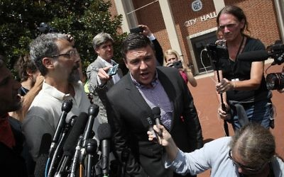 "Counter protesters confront Jason Kessler, an organizer of ""Unite the Right"" rally, after Kessler tried to speak outside the Charlottesville City Hall on August 13, 2017 in Charlottesville, Virginia. (Chip Somodevilla/Getty Images/AFP)"