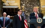 Trailed by (left to right) Director of the National Economic Council Gary Cohn and Treasury Secretary Steve Mnuchin, US President Donald Trump arrives to deliver remarks following a meeting on infrastructure at Trump Tower, August 15, 2017, in New York City. (Drew Angerer/Getty Images/AFP)