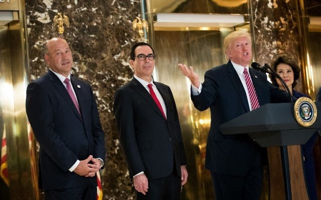 US President Donald Trump delivers remarks following a meeting on infrastructure at Trump Tower, August 15, 2017 in New York City. Standing alongside him from L to R, Director of the National Economic Council Gary Cohn, Treasury Secretary Steve Mnuchin and Transportation Secretary Elaine Chao. (Drew Angerer/Getty Images/AFP)