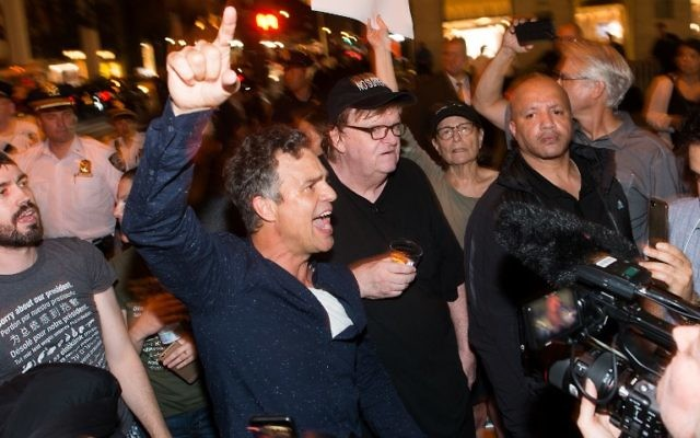 Mark Ruffalo, left, joins Michael Moore, center, as he leads his Broadway audience to Trump Tower to protest President Donald Trump on August 15, 2017 in New York City.  (Noam Galai/Getty Images for DKC/O&M/AFP)