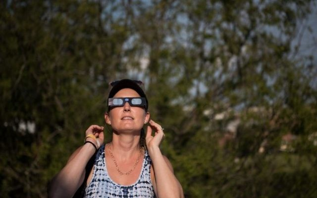 Dana Hamerschlag tests out a pair of eclipse glasses at the South Carolina State Museum August 20, 2017 in Columbia, South Carolina. (Sean Rayford/Getty Images/AFP)
