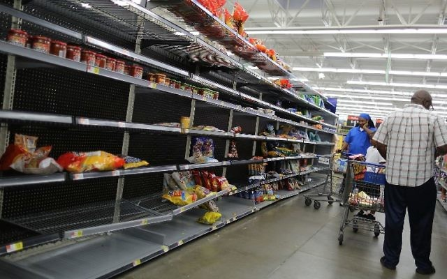 The chips and other bagged foods section of a Walmart store is almost empty as people prepare for the arrival of Hurricane Harvey on August 24, 2017 in Houston, Texas.  (Joe Raedle/Getty Images/AFP)