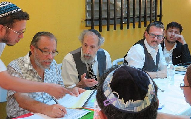 From left to right, Moshe Omar Cohen-Henriquez speaking with beit din members Rabbi Mark Kunis, Rabbi Andy Eichenholz and Rabbi Marc Phillips in Managua, Nicaragua, July 20, 2017. On the far right is Even Centeno, a convert who traces his ancestry to Sephardi Jews who were forced to convert to Christianity. (Bonita Sussman via JTA)