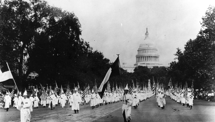 During the 1920s, members of the KKK march in Washington, DC (Public domain)