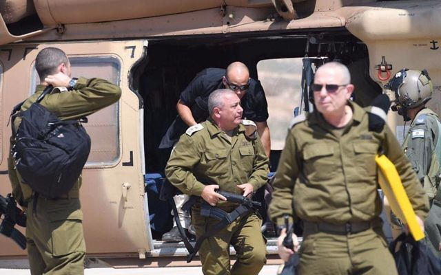 IDF Chief of Staff Gadi Eisenkot gets out of a helicopter ahead of a tour of the barrier surrounding the southern West Bank on August 8, 2017. (Israel Defense Forces/Facebook)