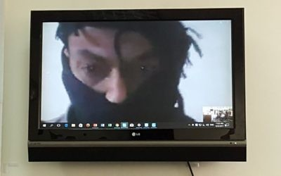 A Syrian rebel commander, known only by his nom de guerre, Abu Hamad speaks to journalists in Jerusalem from Syria via Skype on August 23, 2017. (Media Central)