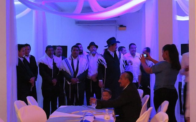 Nicaraguan men who converted to Judaism waiting for their brides prior to a traditional Jewish wedding for 22 couples, July 23, 2017. (Bonita Sussman via JTA)