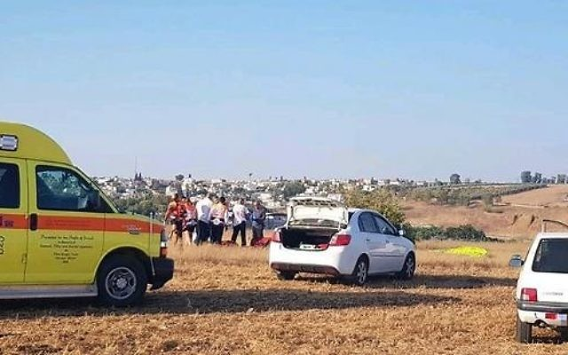 Police and paramedics inspect the scene where a man was killed in a paragliding accident on August 12, 2017. (Magen David Adom)