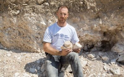 Dr. Yonatan Adler on-site at the stone quarry and tool production center excavations at Reina in Lower Galilee. (Samuel Magal/IAA)