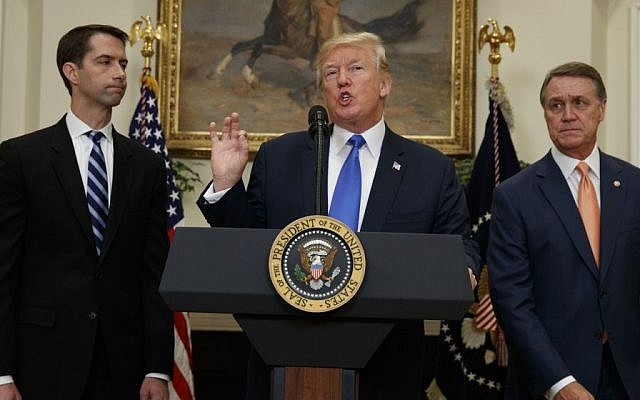 President Donald Trump, flanked by Sen. Tom Cotton, R- Ark., left, and Sen. David Perdue, R-Ga., speaks in the Roosevelt Room of the White House in Washington, Wednesday, Aug. 2, 2017, during the unveiling of legislation that would place new limits on legal immigration. (AP/Evan Vucci)