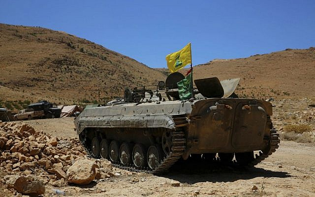 A Hezbollah armored vehicle sits at the site where clashes erupted between Hezbollah and al-Qaeda-linked fighters in Wadi al-Kheil or al-Kheil Valley in the Lebanon-Syria border,  July 29, 2017. (AP Photo/Bilal Hussein)