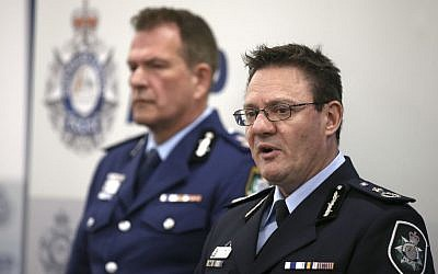 Australian Federal Police Deputy Commissioner Michael Phelan (R) and New South Wales state Police Deputy Commissioner David Hudson discuss details of the charging of two men with terrorism offenses in Sydney, August 4, 2017. (AP Photo/Rick Rycroft)