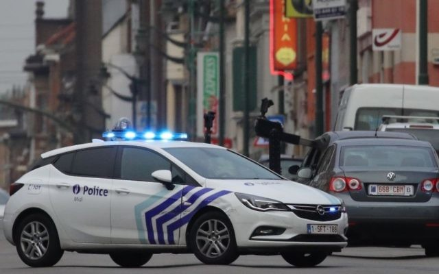 A police vehicle blocks a road in the Molenbeek suburb of Brussels, Tuesday, Aug. 8, 2017. (AP Photo/Olivier Matthys)