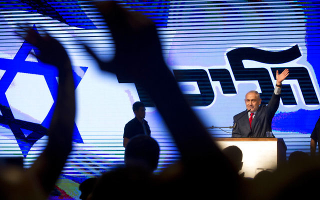Prime Minister Benjamin Netanyahu speaks to Likud supporters at a rally designed to deliver a powerful show of force as he battles a slew of corruption allegations, August 9, 2017. (AP Photo/Oded Balilty)