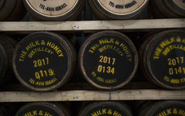 In this Thursday, Aug. 10, 2017 photo, whiskey barrels are seen at the 'Milk and Honey' whiskey distillery in Tel Aviv, Israel. (AP Photo/Sebastian Scheiner)