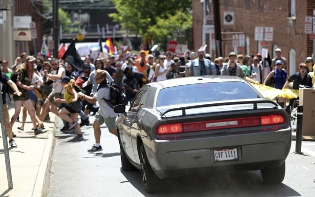 A vehicle drives into a group of protesters demonstrating against a white nationalist rally in Charlottesville, Virginia, August 12, 2017. (Ryan M. Kelly/The Daily Progress via AP)