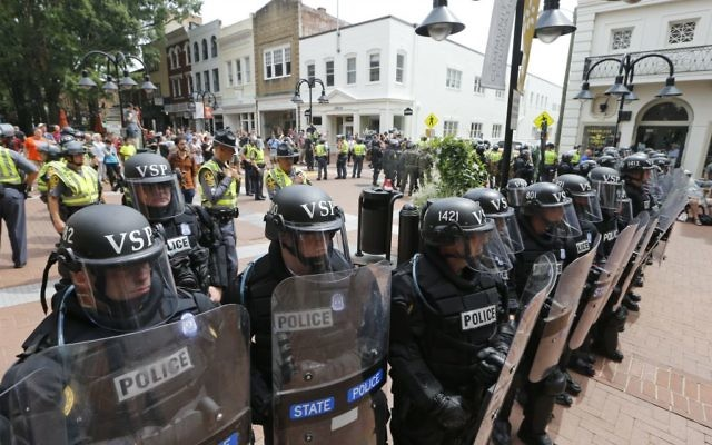 Virginia State Police cordon off an area around the site where a car ran into a group of protesters after a white nationalist rally in Charlottesville, Virginia, August 12, 2017. (AP Photo/Steve Helber)