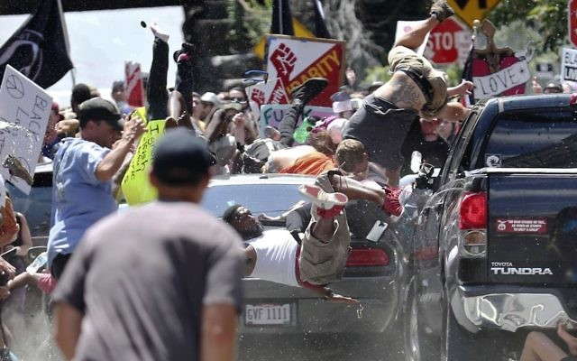 People fly into the air as a vehicle drives into a group of protesters demonstrating against a white nationalist rally in Charlottesville, Virginia, August 12, 2017. (Ryan M. Kelly/The Daily Progress via AP)