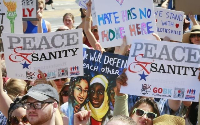 Illustrative: Protesters listen during a 'Peace and Sanity' rally Sunday Aug. 13, 2017, in the Brooklyn borough of New York, during a rally about white supremacy violence in Charlottesville, Va. (AP/Bebeto Matthews)