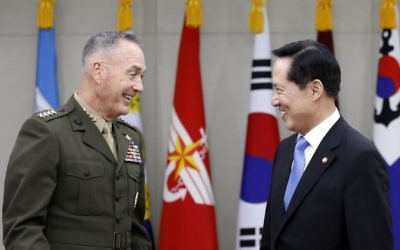 US Joint Chiefs Chairman Gen. Joseph Dunford, left, shakes hands with South Korean Defense Minister Song Young-moo during their meeting at the Defense Ministry in Seoul, South Korea, August 14, 2017. (Kim Hong-Ji/Pool Photo via AP)