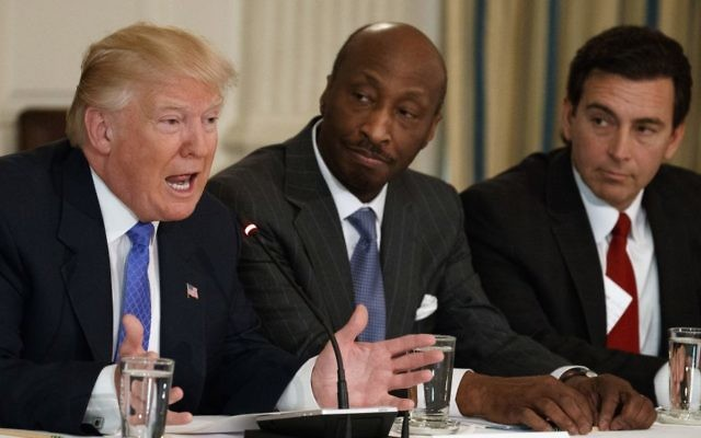 In this Thursday, Feb. 23, 2017, photo, US President Donald Trump, left, speaks during a meeting with manufacturing executives at the White House in Washington, including Merck CEO Kenneth Frazier, center, and Ford CEO Mark Fields. (AP Photo/Evan Vucci)