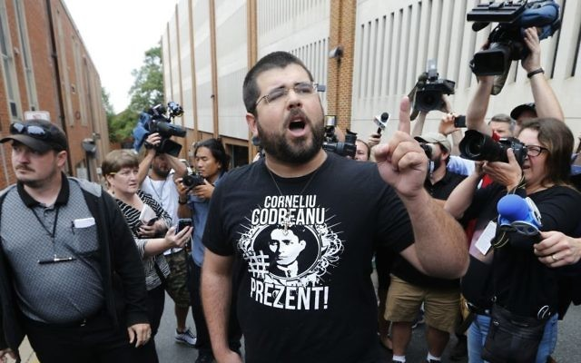 Matthew Heimbach, center, voices his displeasure at the media after a court hearing for James Alex Fields Jr., in front of court in Charlottesville, Va., Monday, Aug. 14, 2017. A judge has denied bond for Fields accused of plowing his car into a crowd at a white nationalist rally. (AP/Steve Helber)