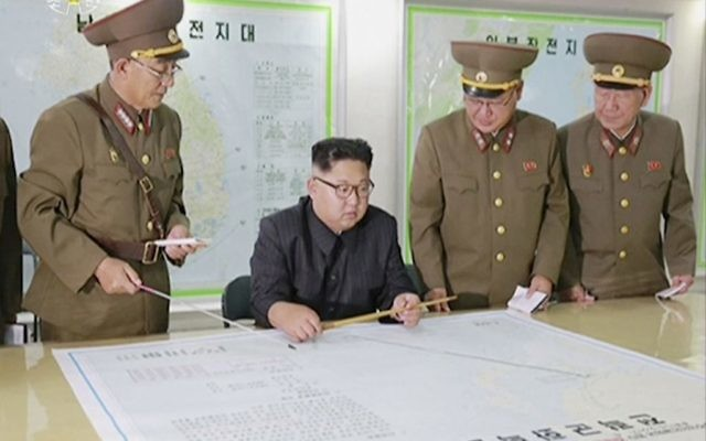 This image made from video of an Aug. 14, 2017, still image broadcast in a news bulletin on August 15, 2017, by North Korea's KRT shows North Korean leader Kim Jong Un receiving a briefing in Pyongyang.(KRT via AP Video)