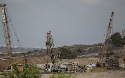 Heavy machinery works on a massive underground barrier that is expected to stretch along the entire 60-kilometer (40-mile) border when it is complete, on the Israeli side of the border with Gaza, September 8, 2016. (AP Photo/Tsafrir Abayov, File)