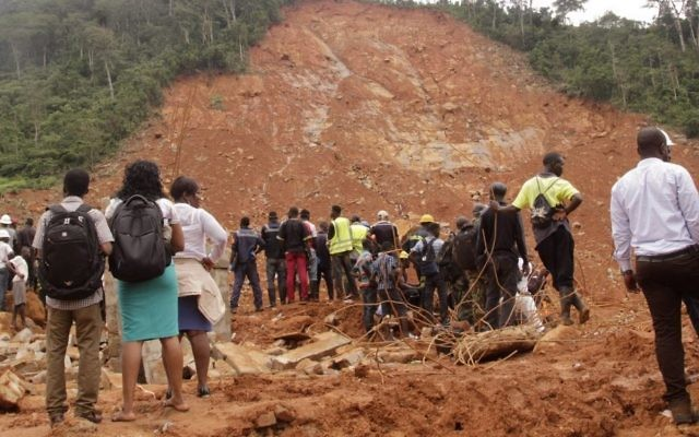 Volunteers wait at the scene of heavy flooding and mudslides in Regent, just outside of Sierra Leone's capital Freetown, Tuesday, Aug. 15 , 2017. (AP Photo/ Kabba Kargbo)
